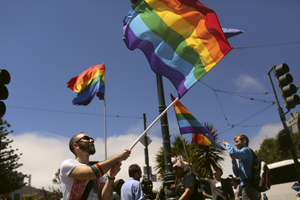 Supporters of same-sex marriage wave flags in the Castro neighborhood in San Francisco